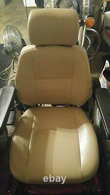 Red Rumba power wheelchair (Medical Equipment). Charges and runs good