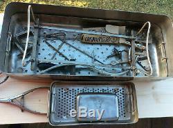 Vintage Medical equipment inc medicine vials and sterilising set in metal case